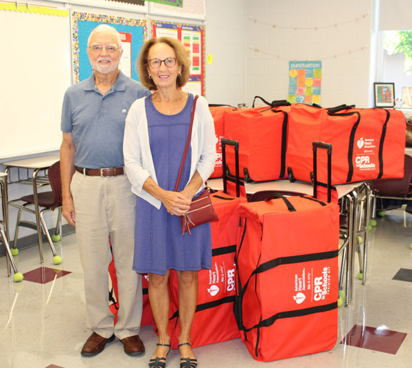 Dr. and Mrs. Hamilton with CPR Kits